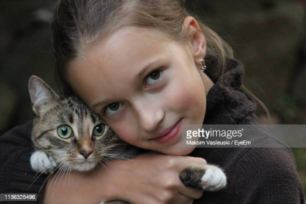 portrait of cute girl with cat - hazel bond stock photos and pictures