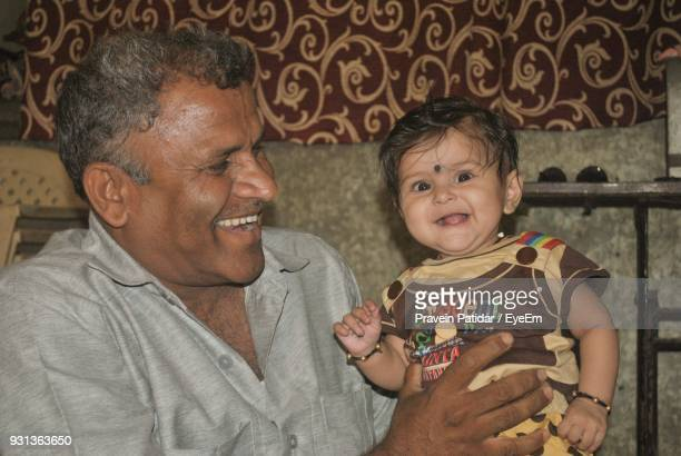 Portrait Of Cute Girl With Father At Home