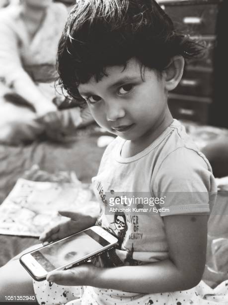 Portrait Of Cute Holding Mobile Phone