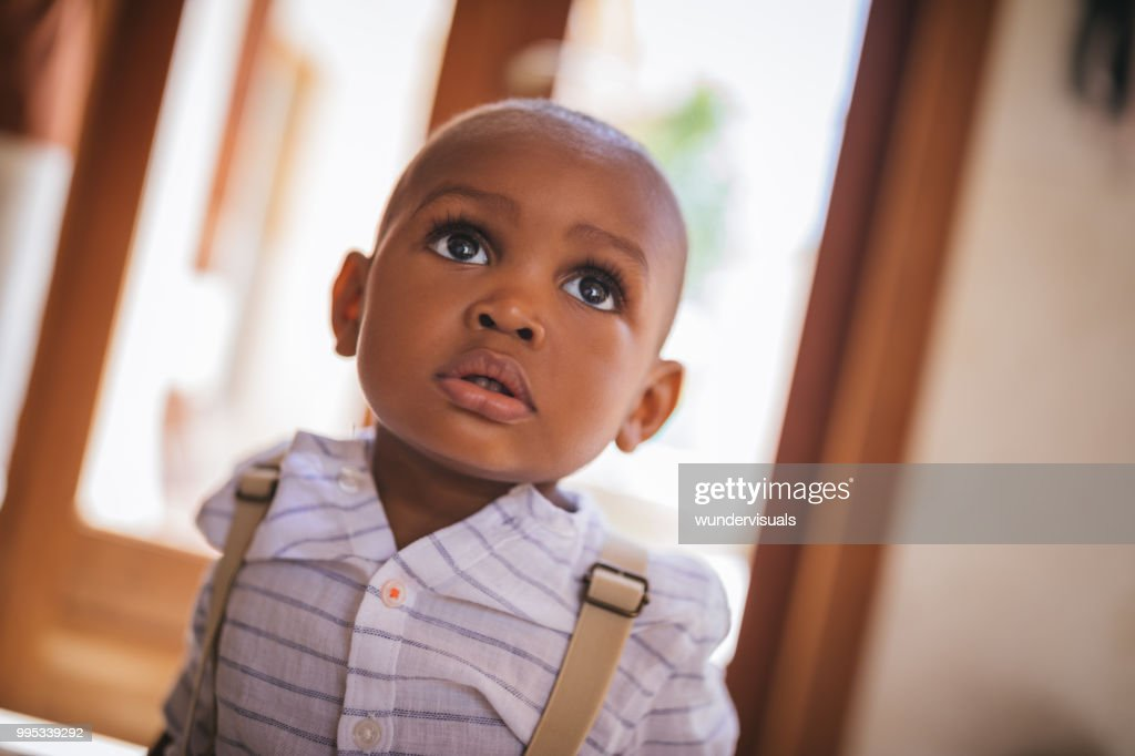 Portrait of cute little baby boy at home : Stock Photo