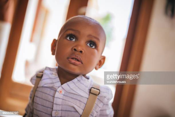 portrait of cute little baby boy at home - big eyes stock photos and pictures