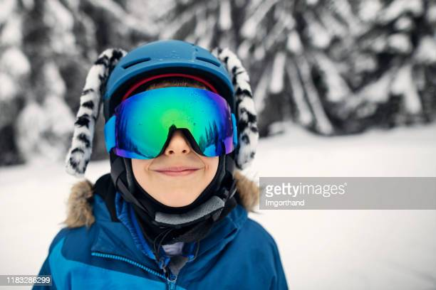 portrait of cute little boy skiing - ski goggles stock pictures, royalty-free photos & images