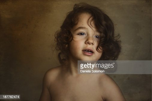 Portrait Of Cute Little Boy With Long Curly Hair Stock