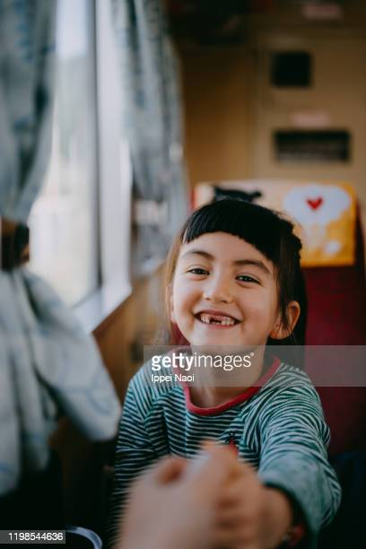 portrait of cute little girl in train - ippei naoi stock pictures, royalty-free photos & images