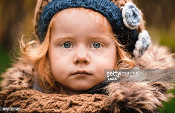 portrait of cute little red haired girl in warm clothing - grey eyes stock pictures, royalty-free photos & images
