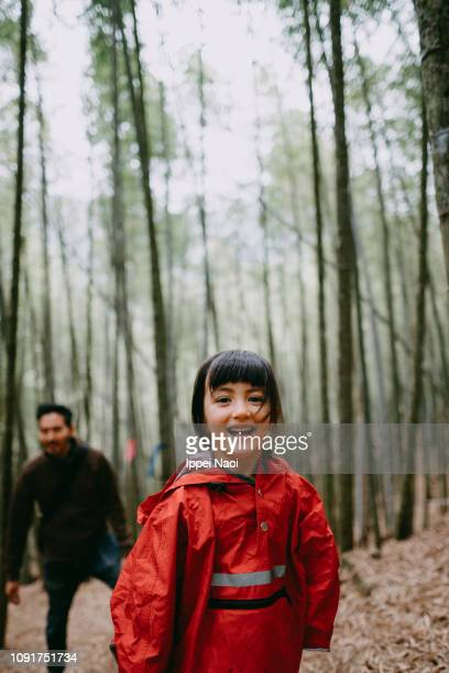 Portrait of cute mixed race girl hiking in bamboo grove