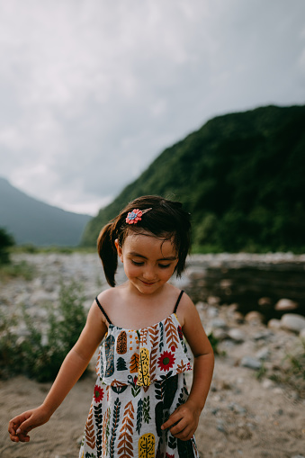 Portrait of cute mixed race little girl by river, Niigata, Japan - gettyimageskorea