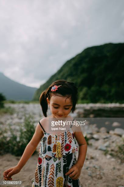 Portrait of cute mixed race little girl by river, Niigata, Japan