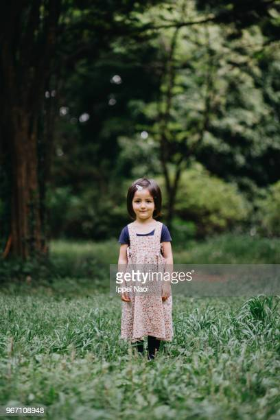 Portrait of cute mixed race toddler girl in nature