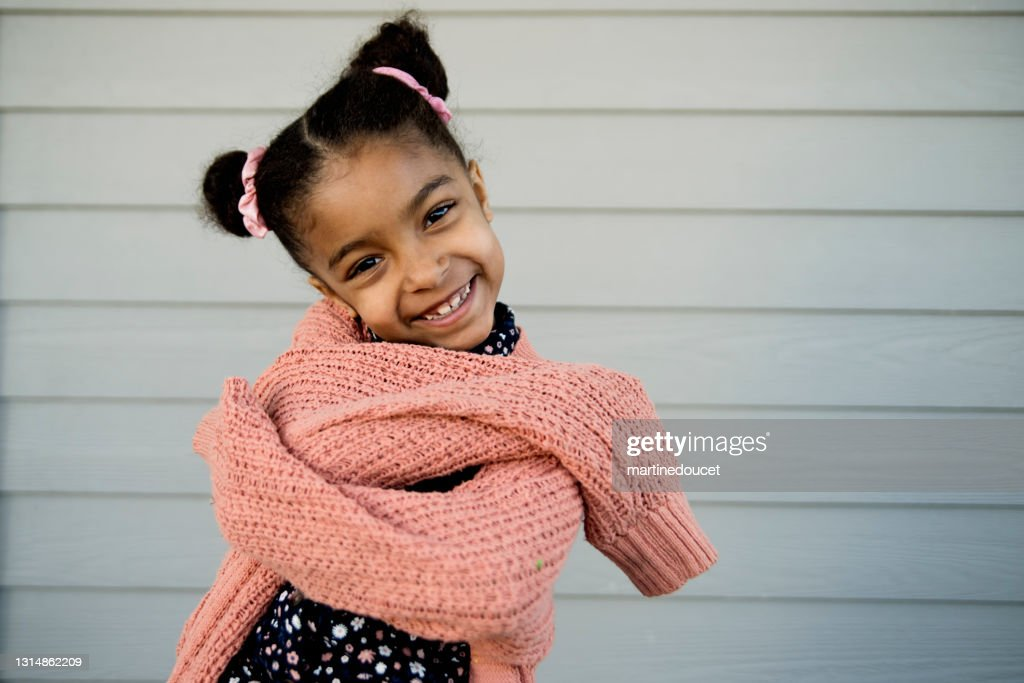 Portrait of cute mixed-race little girl outdoors. : Stock Photo