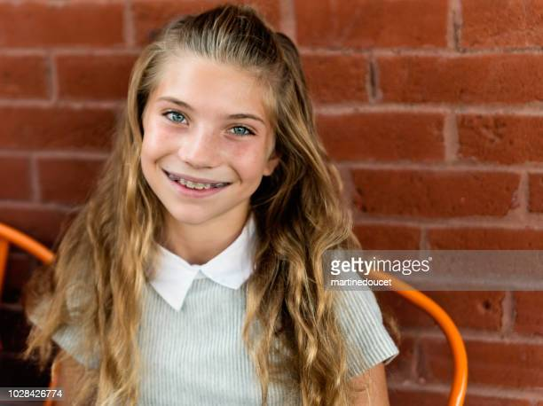 "portrait of cute preteen girl outdoors on a brick wall. - ""martine doucet"" or martinedoucet stock pictures, royalty-free photos & images"