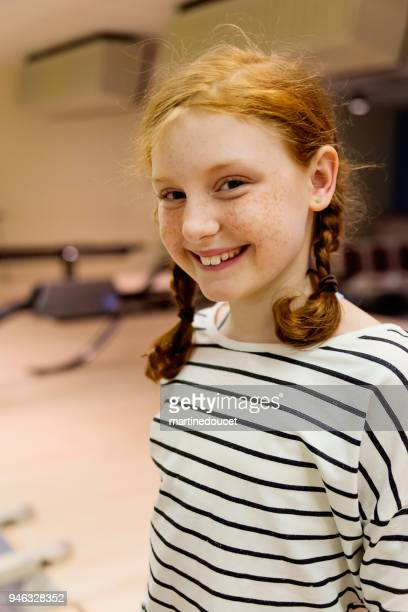"""portrait of cute redhead preteen girl playing bowling. - """"martine doucet"""" or martinedoucet stock pictures, royalty-free photos & images"""