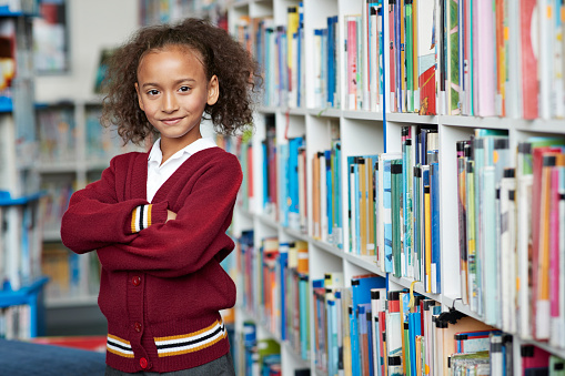 Portrait of cute schoolgirl at the library - gettyimageskorea