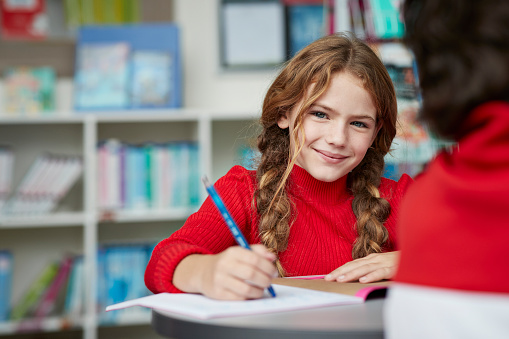 Portrait of cute schoolgirl drawing at the library - gettyimageskorea