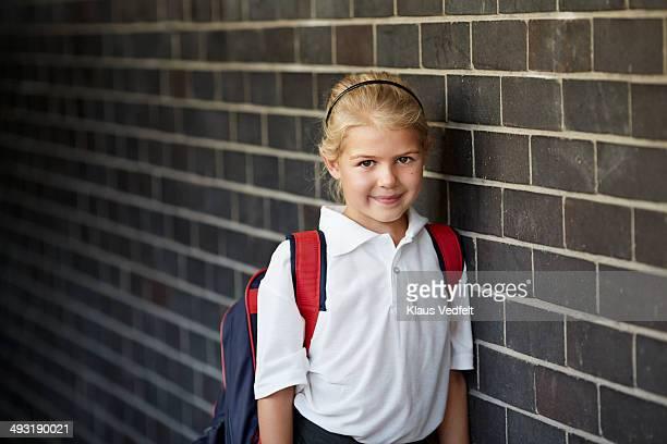 Portrait of cute schoolgirl with schoolbag