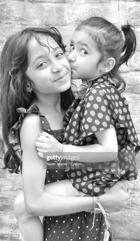Portrait Of Cute Sisters : Stock Photo