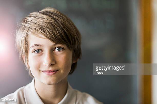 Portrait of cute smiling boy with brown hair