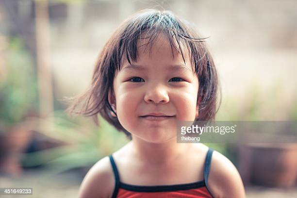 portrait of cute smiling little girl - very young thai girls stock photos and pictures