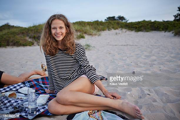 Portrait of cute teen girl hanging out at beach