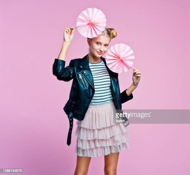 portrait of cute teenege girl holding origami fans wheel - embellished jacket stock pictures, royalty-free photos & images