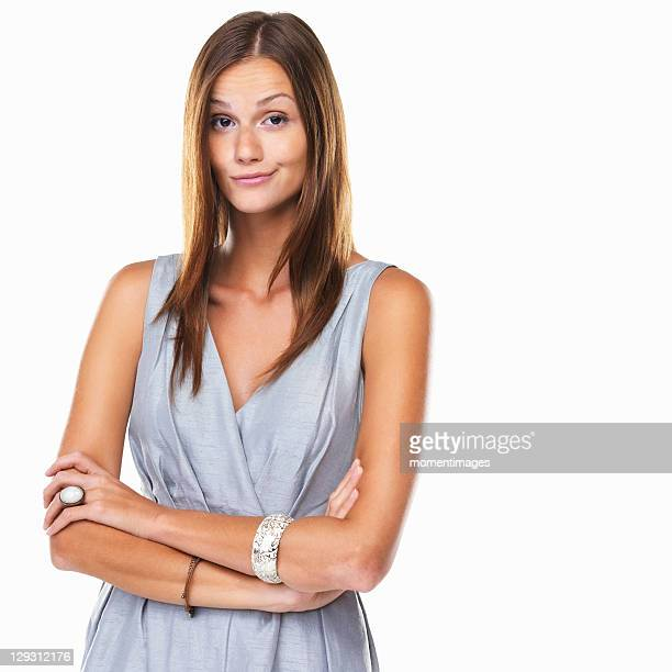 Portrait of cute woman with arms crossed against white background