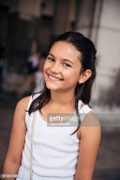 Portrait of cute young girl in New York street.
