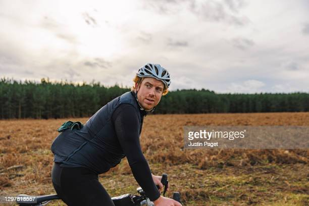 portrait of cyclist in forest clearing - one mid adult man only stock pictures, royalty-free photos & images