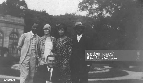 Portrait of Dahomian 'Prince' Kojo Tovalou Houenou , his wife American opera singer Roberta Dodd Crawford , newspaper publisher Robert Sengstacke...