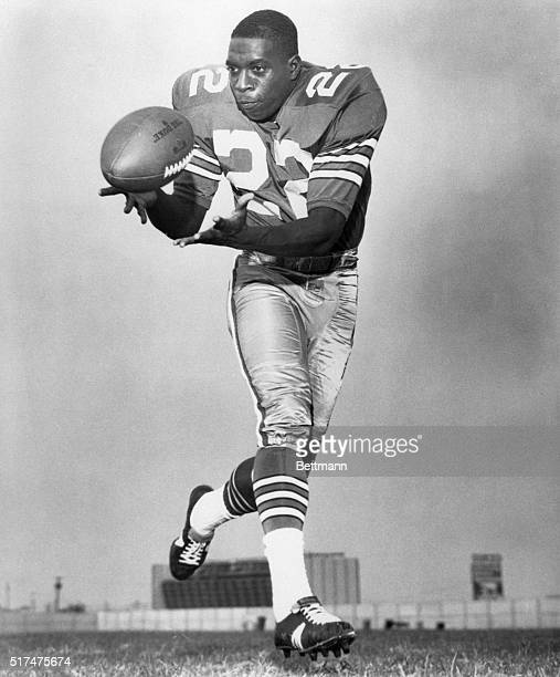 Portrait of Dallas Cowboys player Bob Hayes, making a catch. Undated photograph, circa 1960's.
