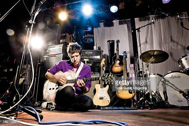 Portrait of Damian Kulash guitarist with American alternative rock group Ok Go posing on a stage with his custom Gibson Les Paul Jr taken on July 27...