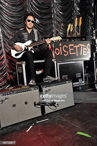 Portrait of Dan Smith guitarist with English indie rock group Noisettes posing with his DiPinto Mach IV guitar in the Bristol Anson Rooms on October...