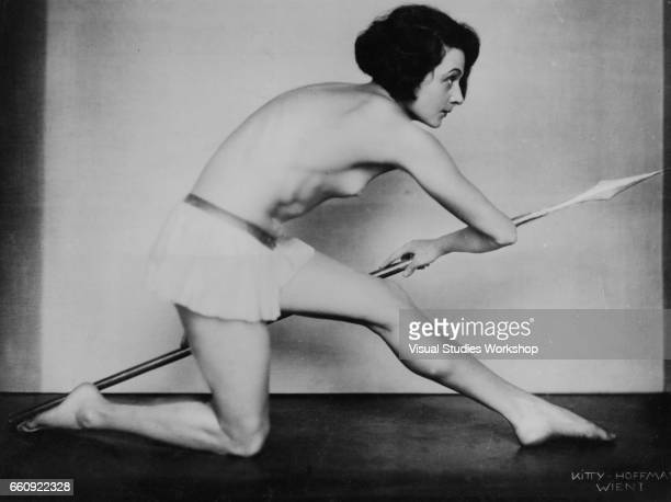 Portrait of dancer Claire Bauroff as she poses topless and with a spear in a scene from a 'Roman Gladiator' tableau vivant Vienna Austria 1934