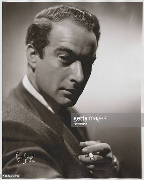 Portrait of Danish pianist and comedian Victor Borge smoking a cigarette