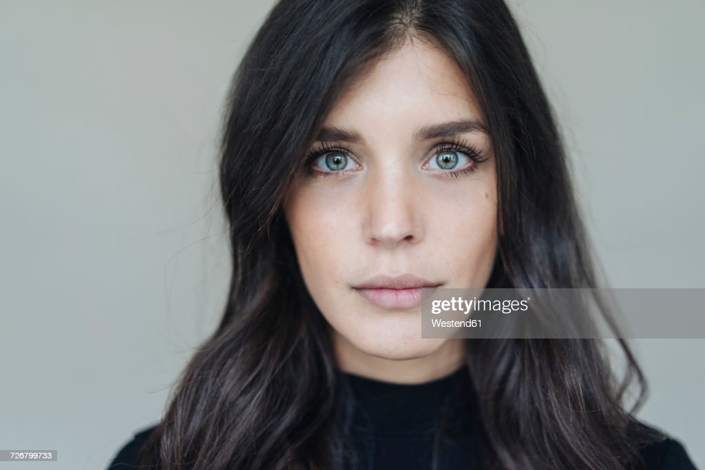 Portrait of dark-haired young woman : Stockfoto