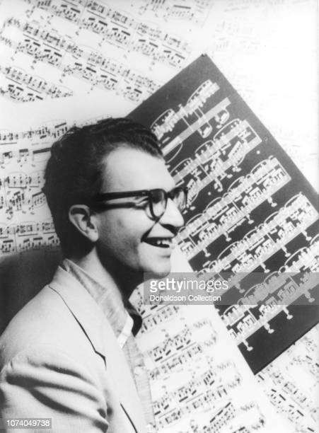 Portrait of Dave Brubeck with sheet music as backdrop