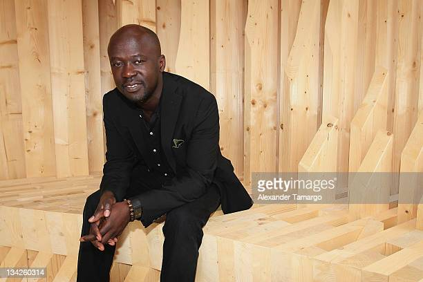 Portrait of David Adjaye with Genesis at the Miami Beach Convention Center on November 29 2011 in Miami Beach Florida