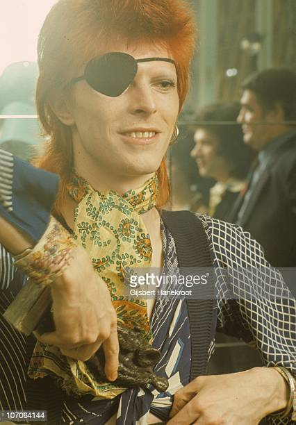 A portrait of David Bowie being interviewed wearing an eye patch at the Amstel Hotel on 7th February 1974 in Amsterdam Netherlands