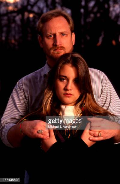 Portrait of David Jewell and his daughter Kiri Waco Texas 1993 Kiri was a child survivor of David Koresh's Branch Davidian cult Shot for Time Magazine