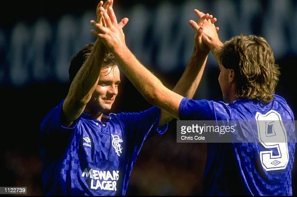 Portrait of Davie Cooper and Ally McCoist of Rangers during a match against Port Allegre at the Ibrox Stadium in Glasgow Scotland The match ended in...