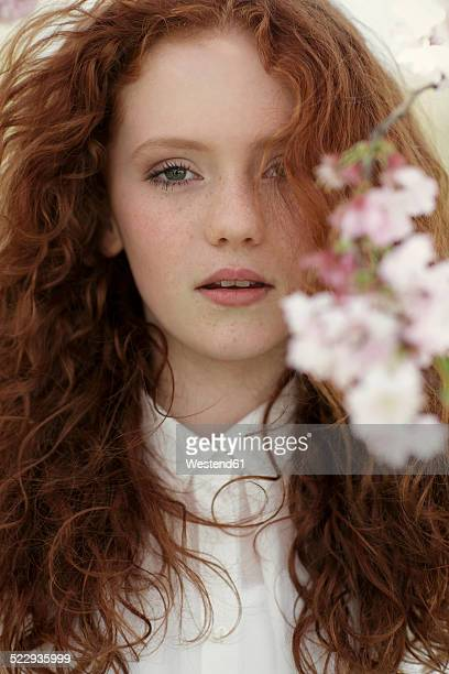 Portrait of daydreaming girl with curly red hair