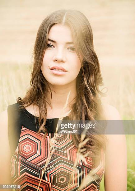 portrait of daydreaming young woman standing on an autumnal meadow - wishful skin stock pictures, royalty-free photos & images