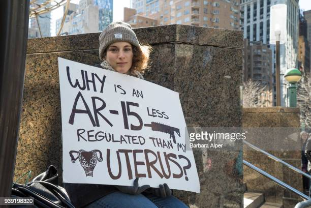 Portrait of demonstrator as she holds a sign that reads 'Why is an A15 Less Regulated than My Uterus' during the March For Our Lives rally against...