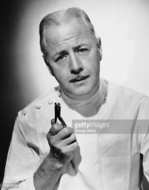 Portrait of dentist with medical instrument
