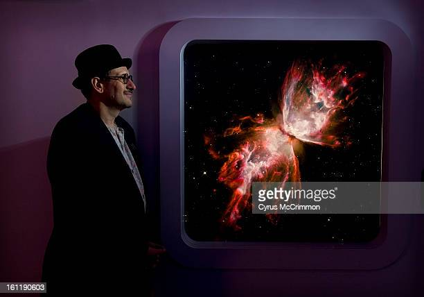 Portrait of Denver Museum of Nature and Science curator of astrobiology David Grinspoon with a image of a butterfly nebula on Thursday July 12 2012...
