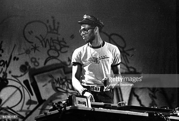 Portrait of Derek Howell or Grandmixer DST spinning some records at a London club 1982