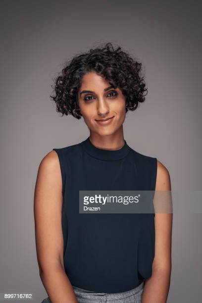 portrait of determined and successful middle eastern woman in studio - female exhibitionist stock photos and pictures