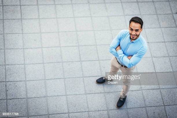 portrait of determined businessman looking up - smart casual stock pictures, royalty-free photos & images
