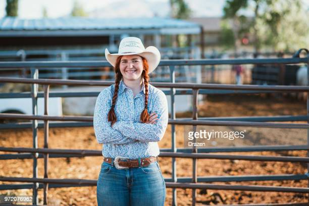 portrait of determined cowgirl on the ranch - cowgirl hairstyles stock photos and pictures
