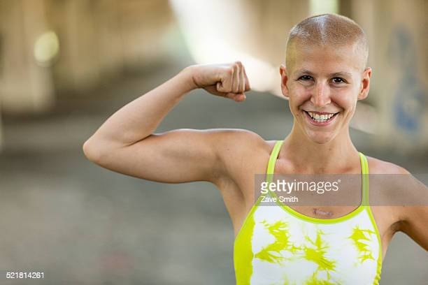 portrait of determined young female cancer survivor - survival stock pictures, royalty-free photos & images