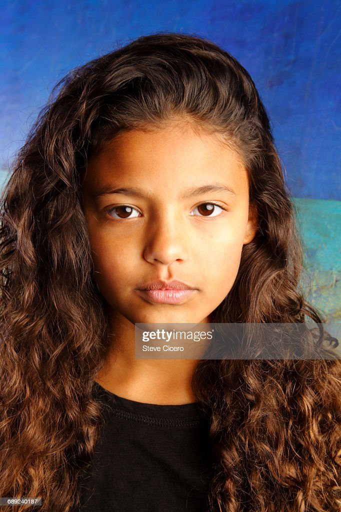 portrait of determined young girl : Stock Photo